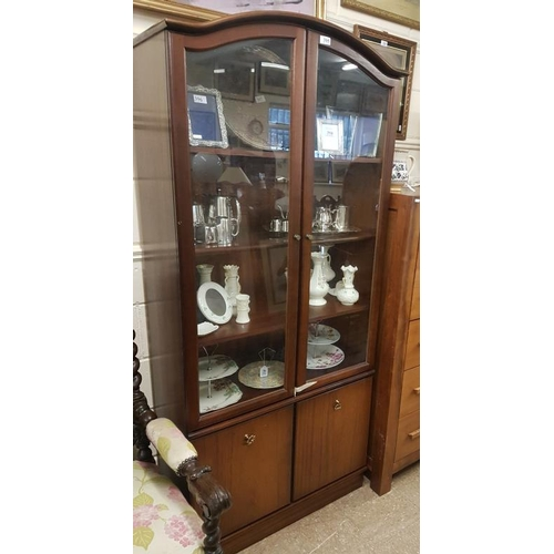 39 - Modern Two Door Display Cabinet, the arched top with glazed doors above two lower cupboards, c.32.5 ...