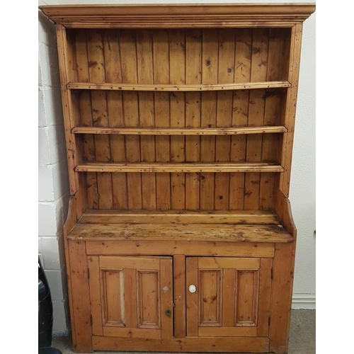 14 - 19th Century Irish Farmhouse Dresser with a moulded top over three open shelves on a base with a pai...