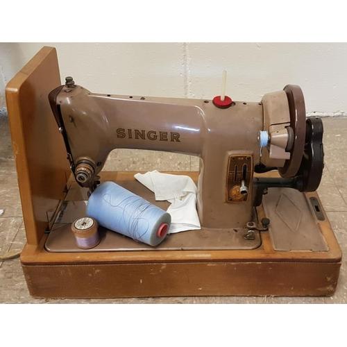 75 - Singer Sewing Machine...