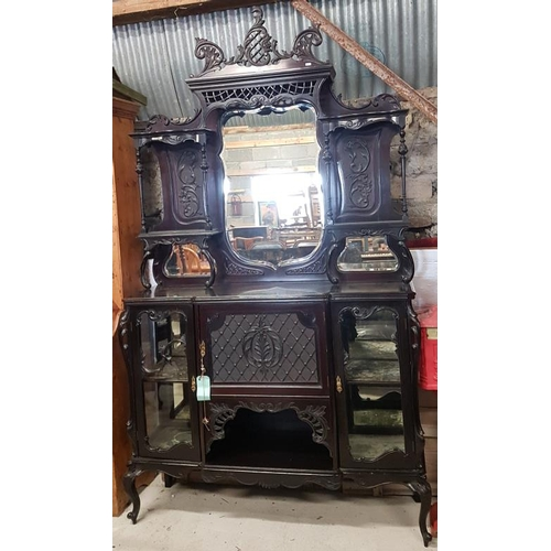 13 - Highly Decorative Carved and Ebonised Display Cabinet with bevelled mirror panels, c.54 x 96in...