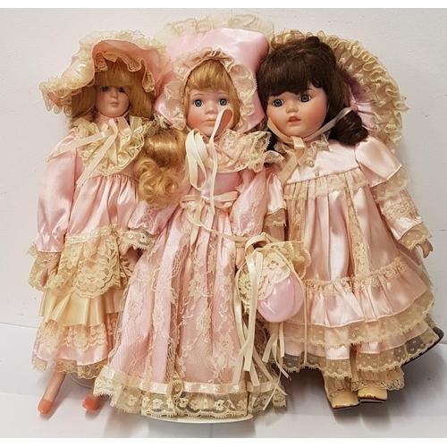 128 - Three Old Style Dressed Dolls...