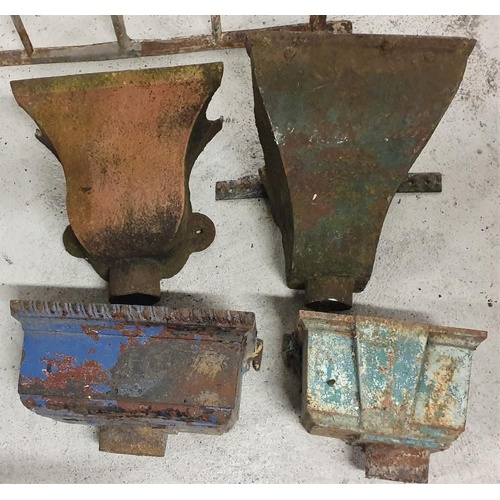 41 - Four Large Cast Iron Water Hoppers...