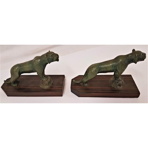 166 - Pair of Art Deco Bronzed effect Lions on Zebra Wood bases. Nice patination - 7.5 x 5ins...