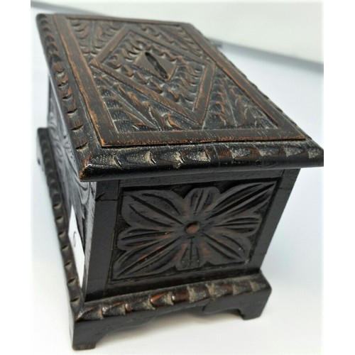 6 - A 19thCentury carved oak money box in the form of a coffer, Floral carveddesign .T...