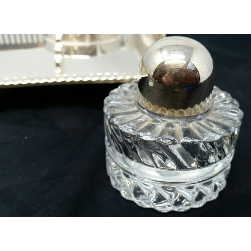 12 - A good quality early tomid 20thCentury silver plated desk set with two glass ink wells w...