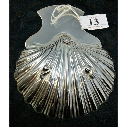 13 - 19thCentury Silver plated scallopdish withengraved IrishWolfhound.The entire resting on three c...