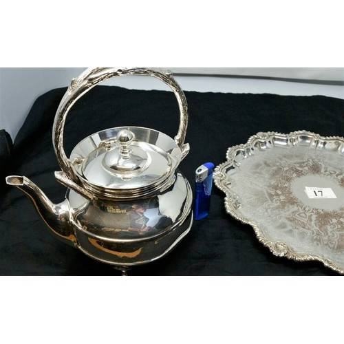 17 - A heavy quality silver plated serving tray 12 inches diameter and a heavy quality tea pot both in us...