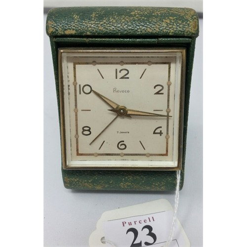 23 - A vintage Retro travel clock with a green shagreen case in full working condition...