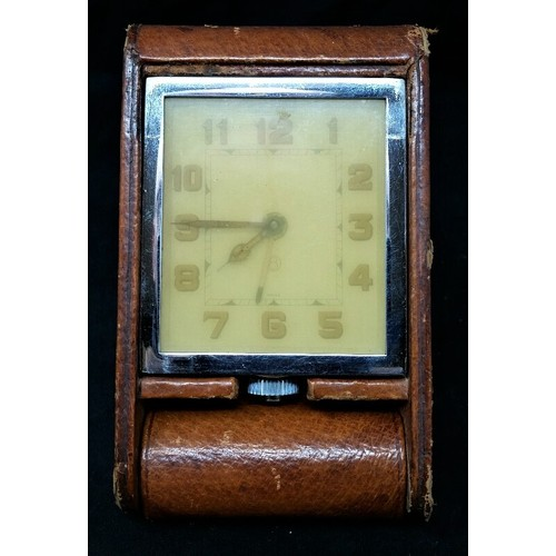 47 - Jaeger- Le Coultre vintage travel clock in leather case. Clock has been wound and is working. Some l...