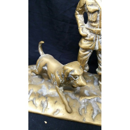 56 - Early tomid 20thcentury heavy brasshuntsmanwith dog 10 inches wide x 8 inche...