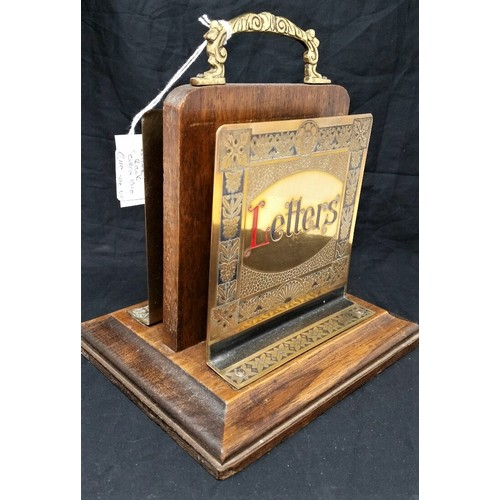 58 - Early 20th century double sided letter rack with painted brass panels on a mahogany base...