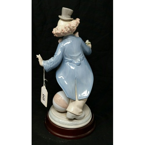 60 - Lladro figure 2002 on a wooden base 10.5 inches tall. No visible damage whatsoever....