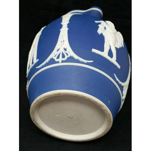 62 - Late 19thCentury Jasper ware water or milk jug in the classicaldesign .No chips or...