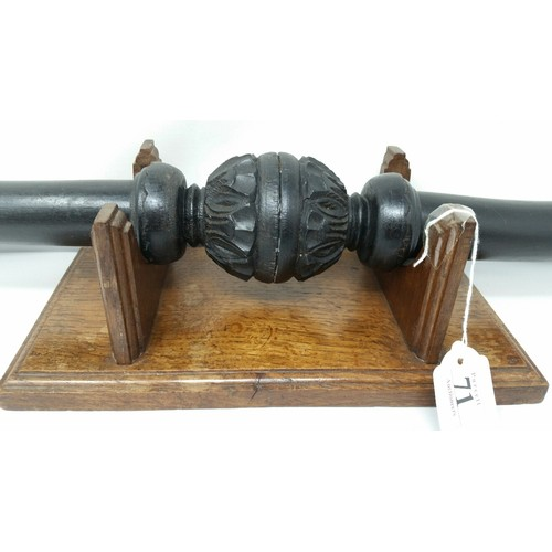 71 - Unusual ebonised carved wood horns on an oak base Early 20thCentury. Horns tip to tip 24 inche...
