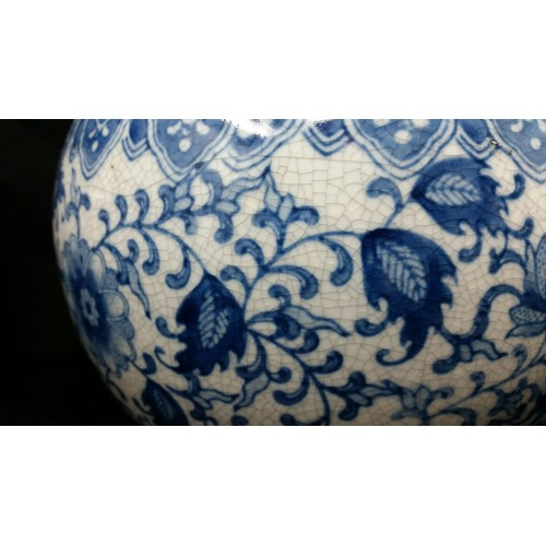 72 - A large pair of late 20thcentury bottle neck vases with underglaze blue floral pattern. No chi...