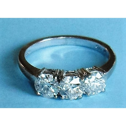 172 - An 18ct white gold three-stone claw set brilliant-cut diamond ring, approx. 1.3 carat, eye clean, 5....
