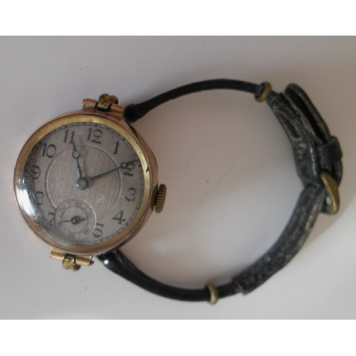 270 - A lady's 9ct gold cased trench-style wristwatch with silvered dial (25 mm diameter), Arabic numerals...