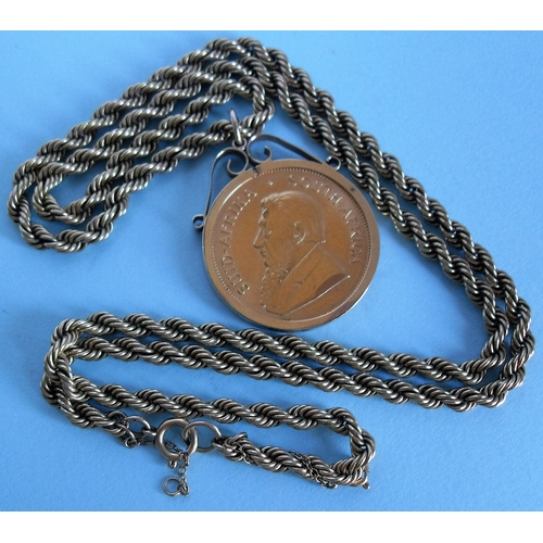 268 - A South African 1oz Kruggerand coin in a 9ct gold mount and chain, gross weight: 85.08g...