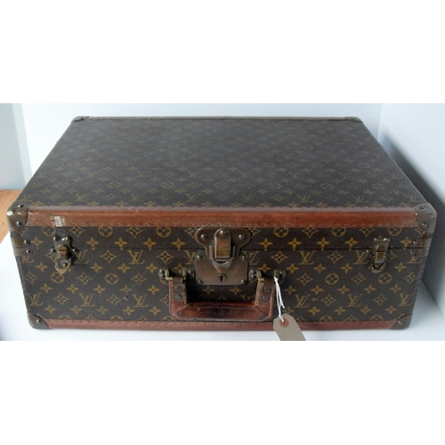 41 - A vintage Louis Vuitton hard-sided Brevete suitcase in monogram canvas. The suitcase composite leath...