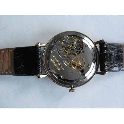 122 - A Jaeger LeCoultre 1956 gentleman's 9ct gold wrist watch, silvered round dial with applied alternati...