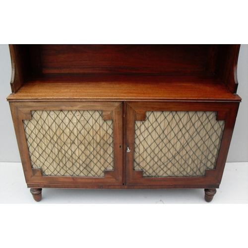 17 - A pair of Regency mahogany waterfall cabinets with three-quarter gallery surround to top, two cupboa...