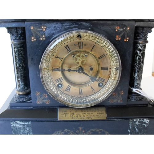 12 - A Victorian slate and marble mantle clock with circular brass dial, Roman numerals, in working order...