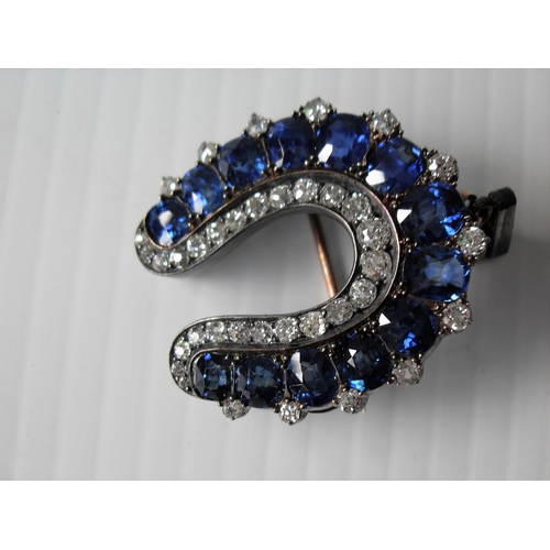 258 - An Edwardian  gold, silver, sapphire and diamond horseshoe brooch with thirteen cushion-shaped sapph...
