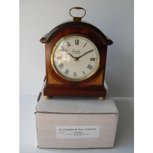 13 - O. Comitti & Son, an Edwardian-style inlaid, broken arch mantle clock, boxed, as new...