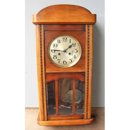 14 - An early 20th century oak-cased wall clock with Arabic numerals, in working order...