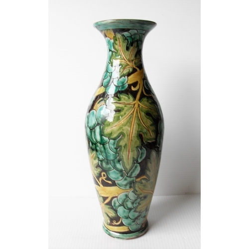 127 - An Art Nouveau Della Robbia baluster earthenware vase with flared rim with stylized foliate sgrafitt...