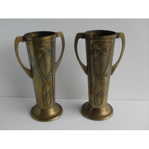 129 - A pair of Beldray Art Nouveau brass two-handled vase on circular bases, 22cm H...