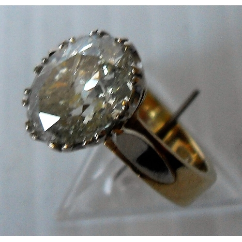 250 - A diamond single stone ring. The oval cut diamond measuring approx. 10.42mm x 7.87mm x 4.97mm depth....