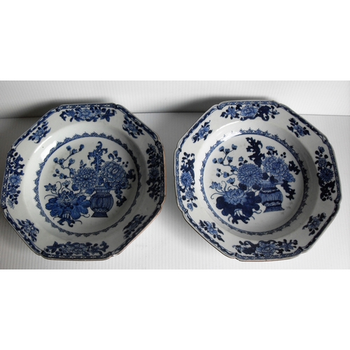 144 - A pair of 18th century tin-glaze octagonal delftware plates painted with bowls of flowers and Daoist...