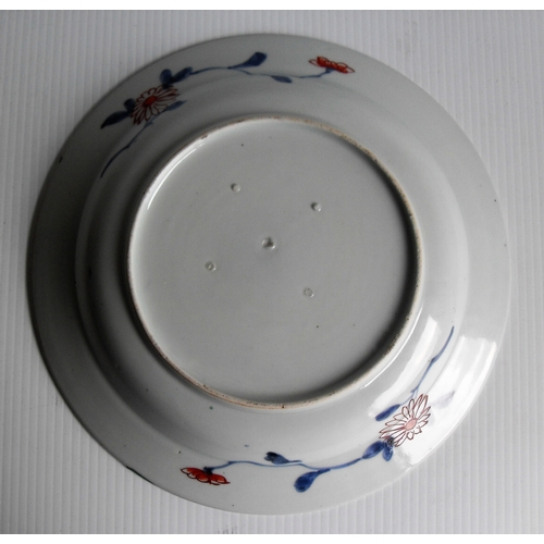 147 - Two early 19th century Japanese Imari plates with blue, ochre and gilt basket of chrysanthemum decor...