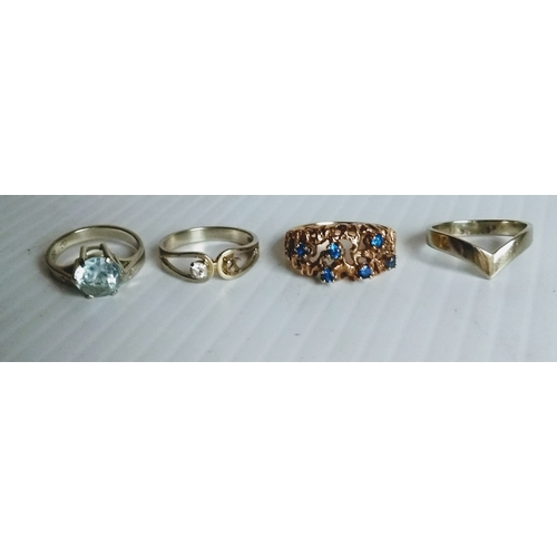 266 - An 18ct yellow gold ring decorated with six-sapphire stones, size N, not hallmarked but testing for ...
