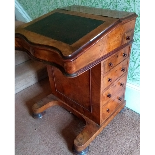 13 - A Victorian walnut davenport with lift-up lid, side drawers on bun feet, 30 x 56 x 56 cm...