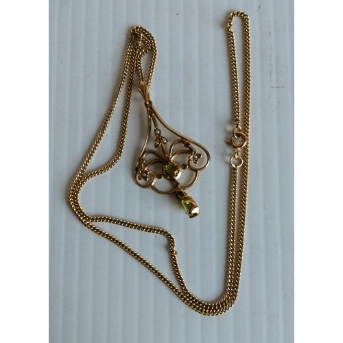 232 - An Art Nouveau peridot and seed pearl pendant on 9ct yellow gold frame and neck chain, 45cm, 6.07g...