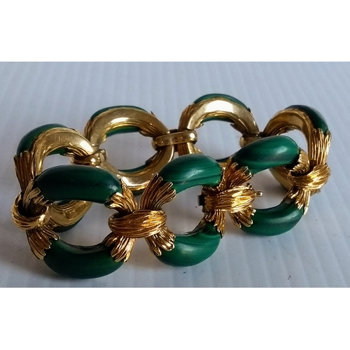 233 - An 18ct yellow gold and malachite bracelet, signed and numbered Mellerio 2470 Br, double struck with...