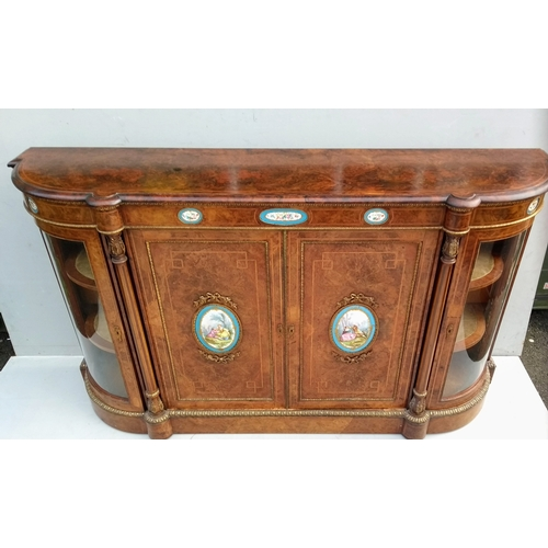 25 - A Victorian burr-walnut credenza with Sevres-style porcelain plaque inserts, brass beading, carved C...