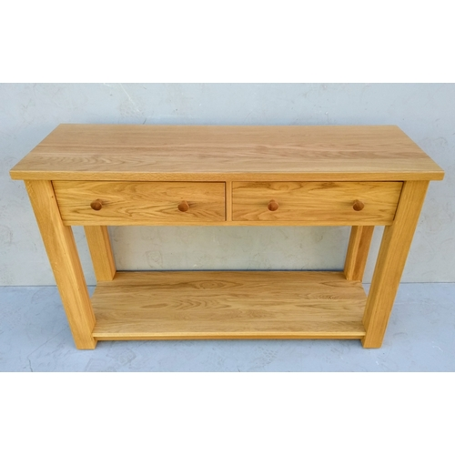 15 - A contemporary light solid oak consul table with frieze drawers, 7 7H x 122 W x 40 cm D (legs 7x7 cm...