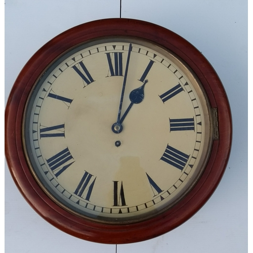 A 19th century mahogany-framed wall clock, in working order with key, dial 36 cm diameter, overall 46 cm diameter