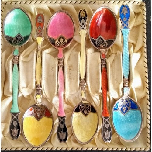 A cased set of six silver and enamel decorated coffee spoons, possibly Egyptian. Condition: enamel worn on bowl of yellow spoon, see photo