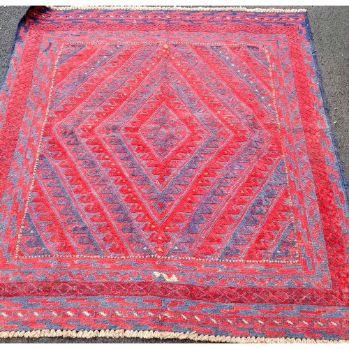 28 - A tribal Kazak hand-knotted wool rug with multicoloured isometric design, 130 x 121 cm in good condi...