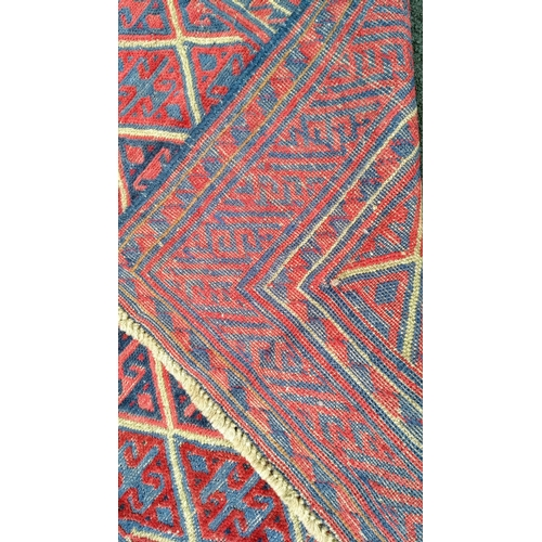 32 - A tribal Kazak hand-knotted wool rug with multicoloured isometric design, 125 x 118 cm in good condi...