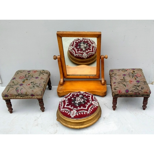 21 - A Victorian satinwood vanity mirror on crutch supports, 48 cm H and three footstools (4)...