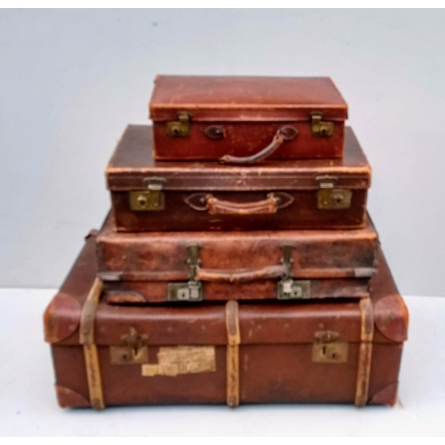14 - A set of four graduated vintage suitcases...