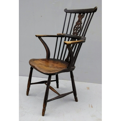 12 - An 18th century Windsor armchair with wheel-back and spindle support, elm seat and H-stretcher base,...