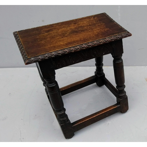 11 - An 18th century oak joint stool with carved rim and frieze with turned and stretcher supports, 50 x ...