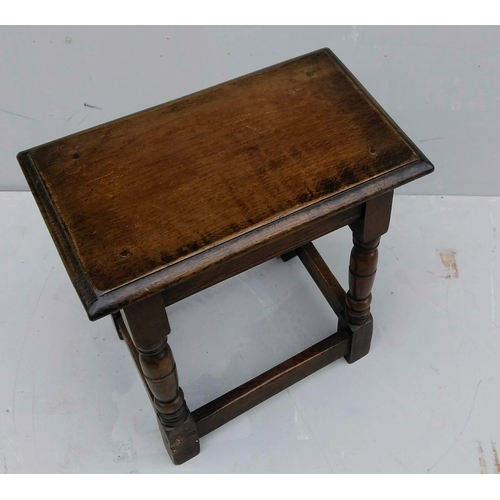9 - An 18th century oak joint stool with turned and stretcher supports, 49 x 46 x 27 cm...