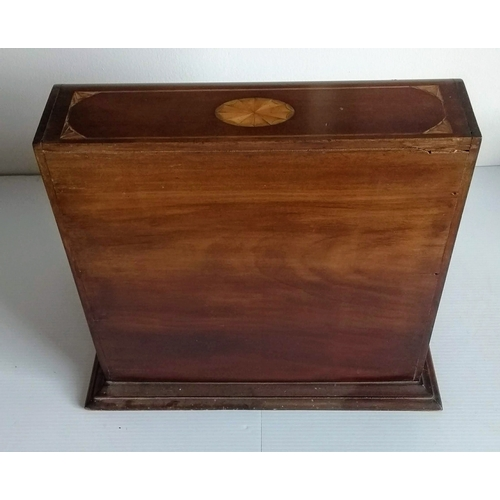 29 - An Edwardian Sheraton revival Tantalus/games box, with three cut-glass bottles concealed by mirrored...